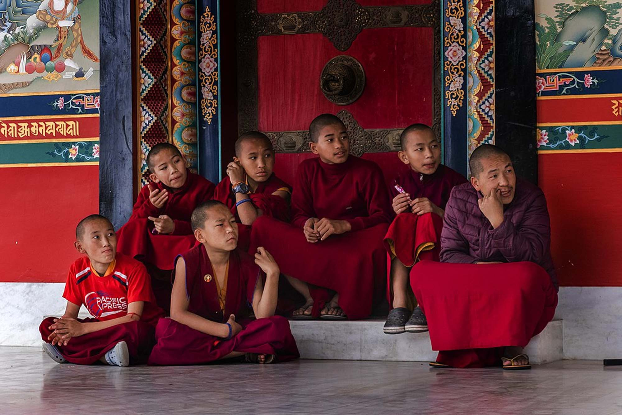 Young monks on a doorstep, Nepal