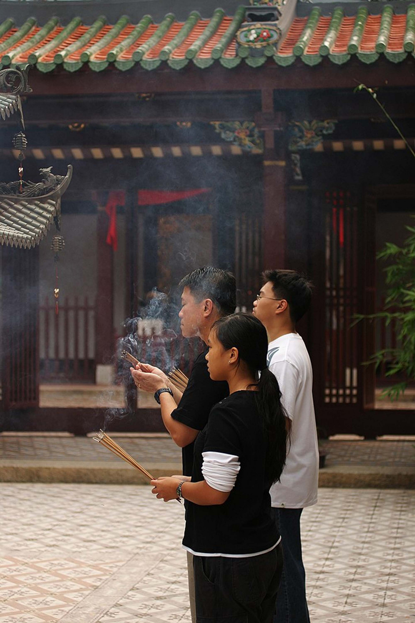 Lay Buddhists performing a ritual, Thian Hock Keng temple, Singapore