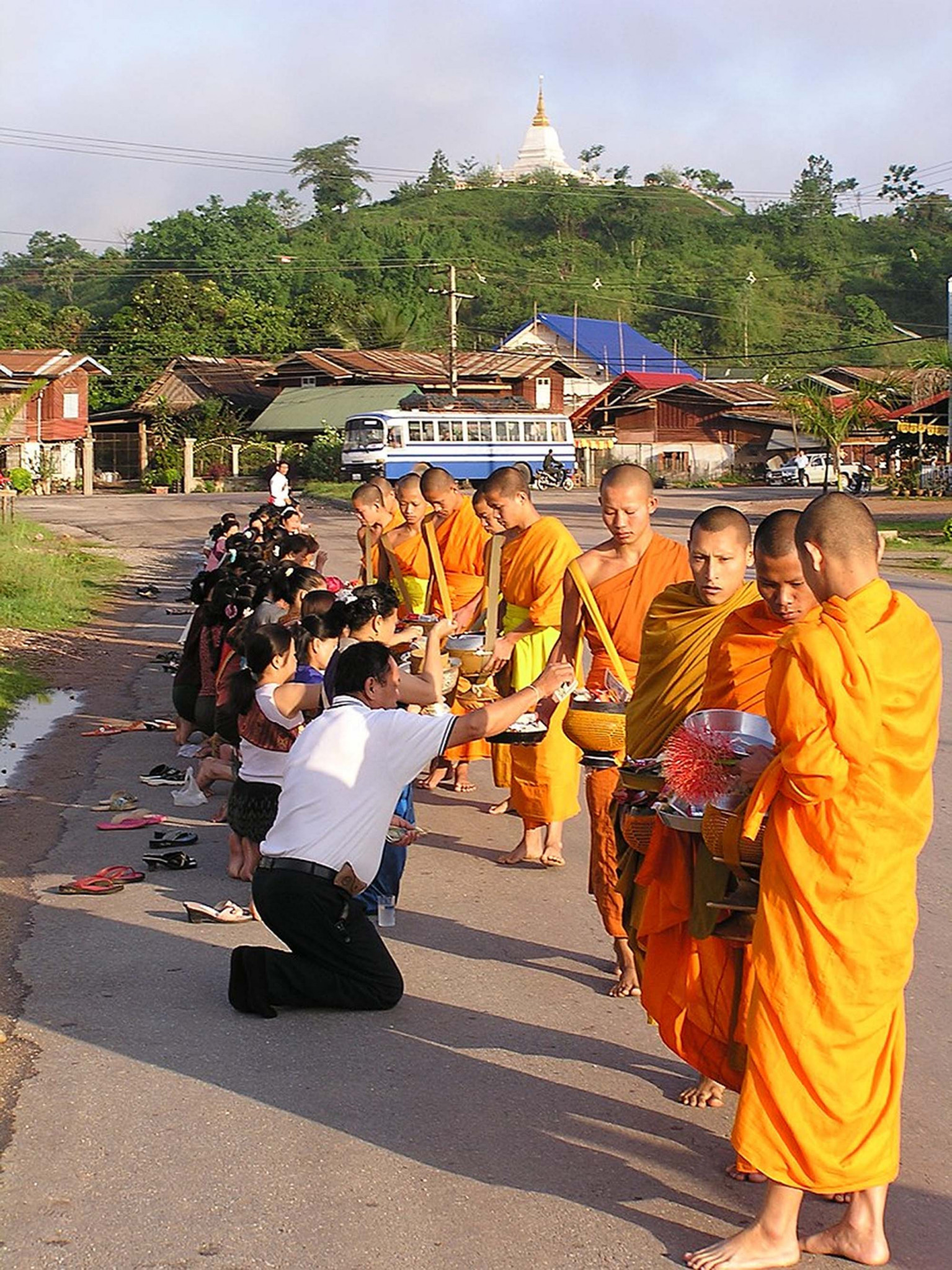 Monks receiving alms, Phou That temple, Laos
