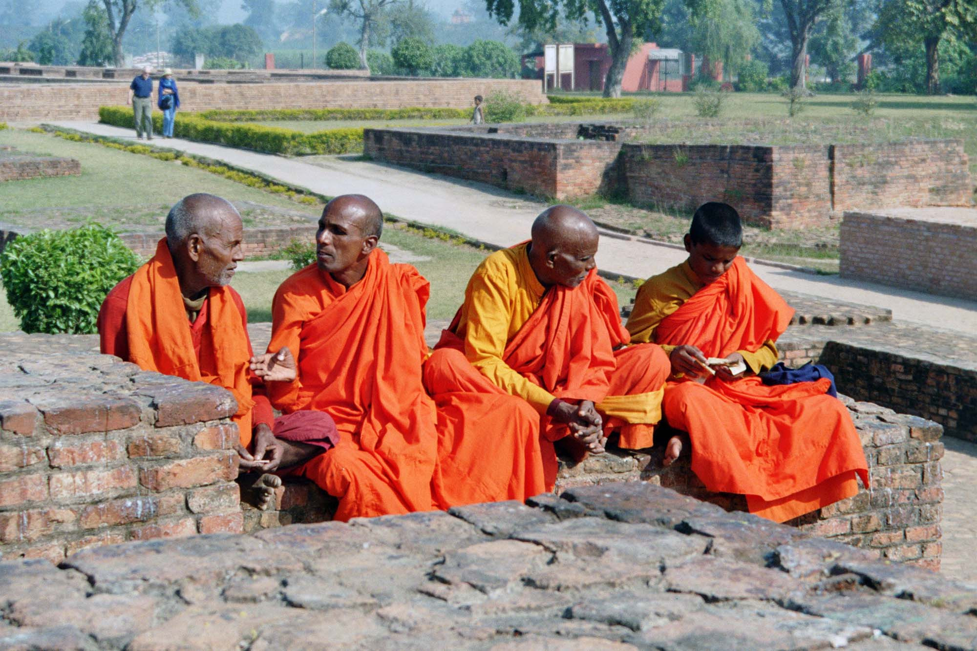 Monks and novices in conversation, Ruins of the ancient Buddhist monastery at Shravasti, India.