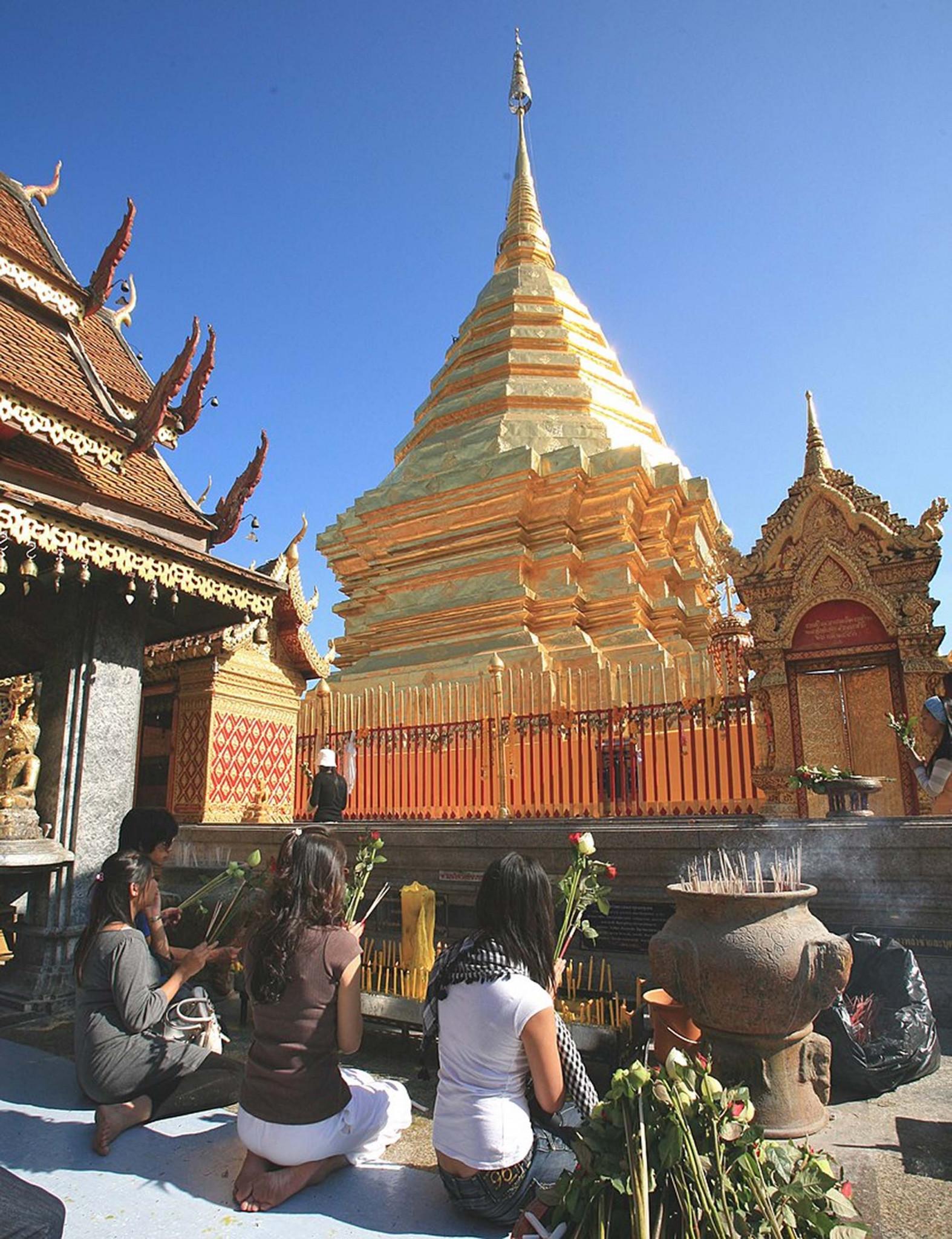 Buddhist laywomen making offerings, Phra That Doi Suthep temple, Chiang Mai province, Thailand