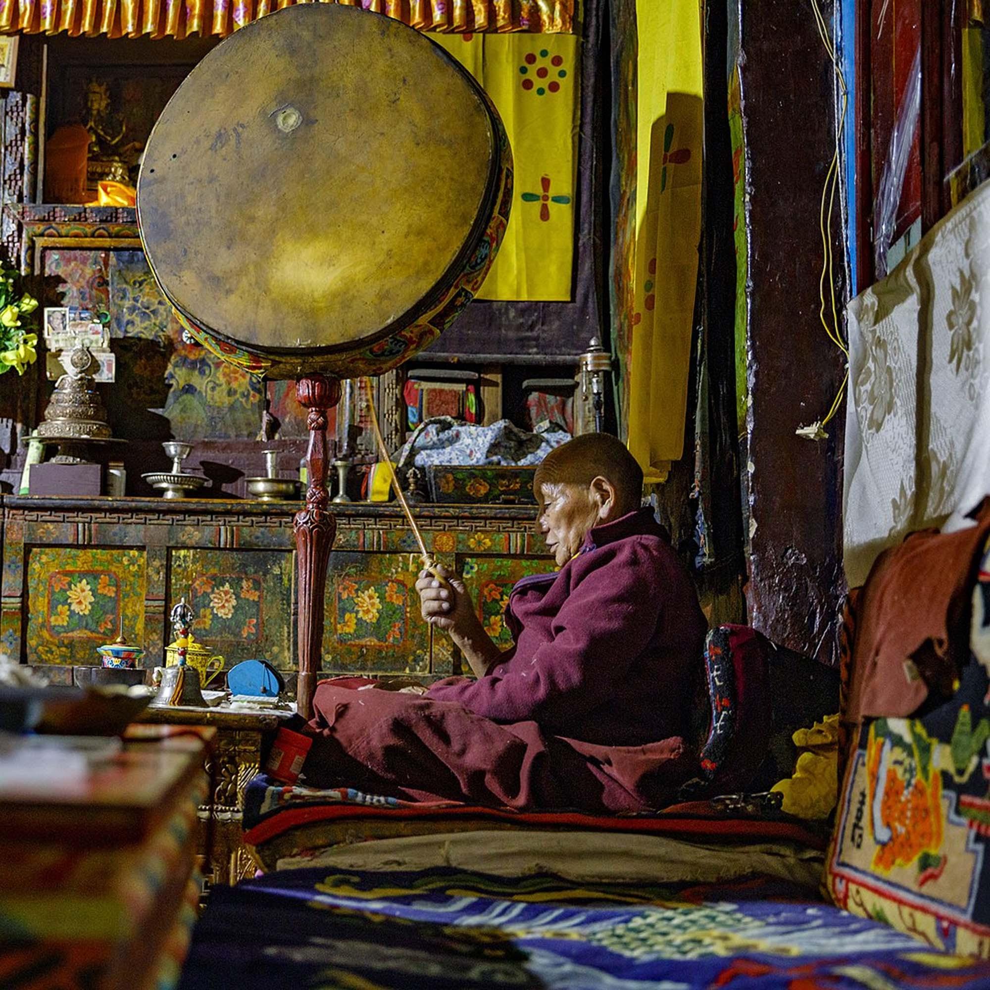 Tibetan monk reciting a sacred text, Mustang, Nepal